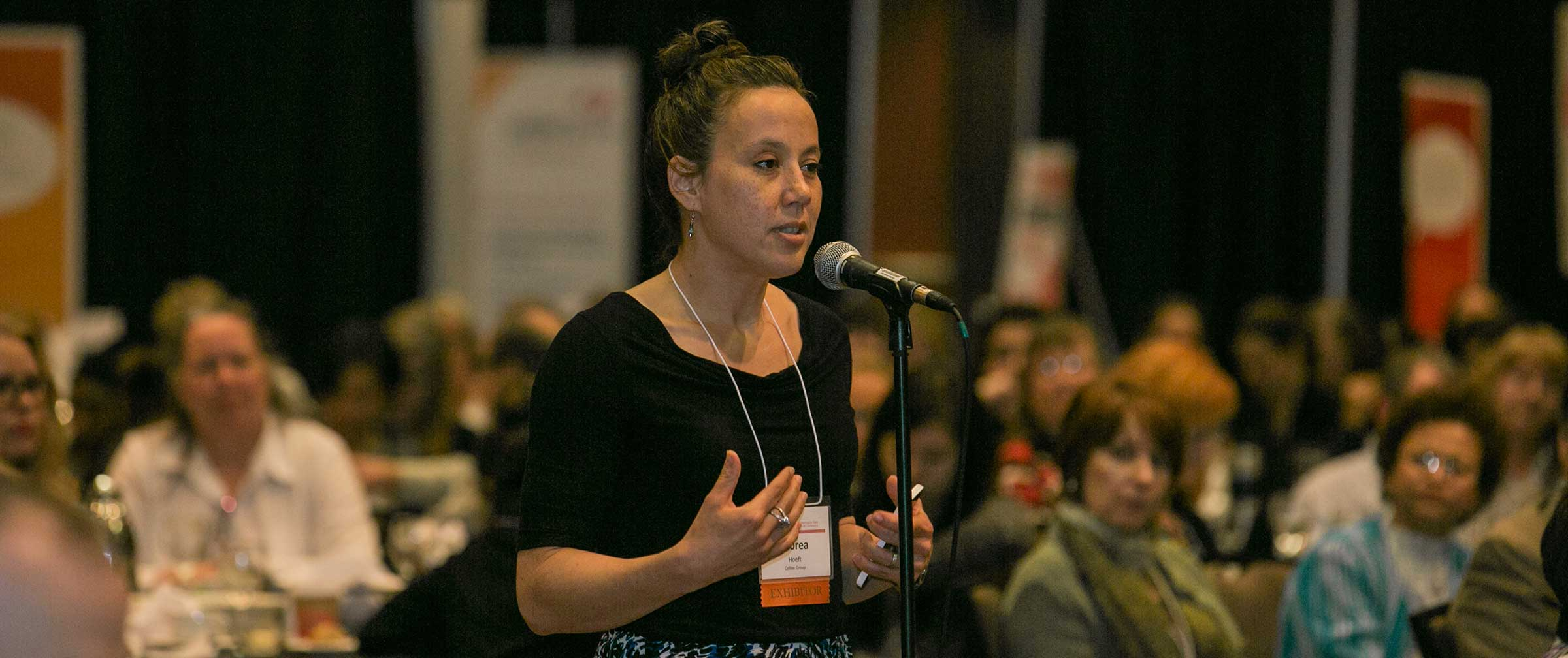 Conference attendee at microphone